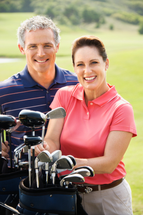 Couple on golf course.