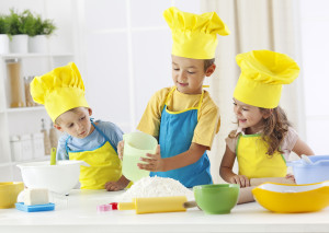 Three children having fun in the kitchen
